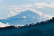 A tall mountain rises above Bellavista Cloud Forest Reserve, near Quito, Ecuador, South America.