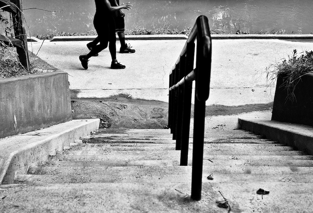 Black and white photograph looking down steps at two people walking at Freedom Park in Charlotte, NC.