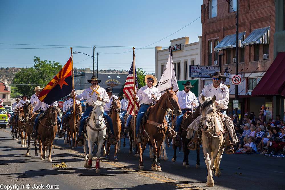 30 JUNE 2012 - PRESCOTT, AZ:   A unit in the Prescott Frontier Days Rodeo Parade. The parade is marking its 125th year. It is one of the largest 4th of July Parades in Arizona. Prescott, about 100 miles north of Phoenix, was the first territorial capital of Arizona.   PHOTO BY JACK KURTZ