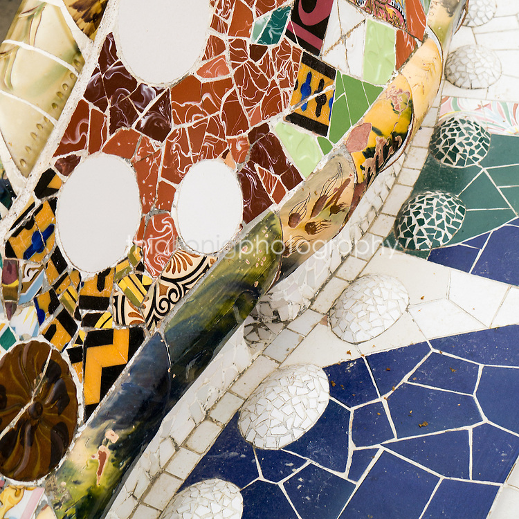 Detail of Gaudi's mosaic curved bench at Park Guell, Barcelona, Spain