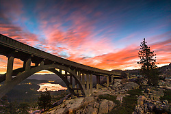 """""""Sunrise at Rainbow Bridge 5"""" - This fiery sunrise was photographed at Rainbow Bridge, also called Donner Summit Bridge, above Donner Lake and Truckee, California."""