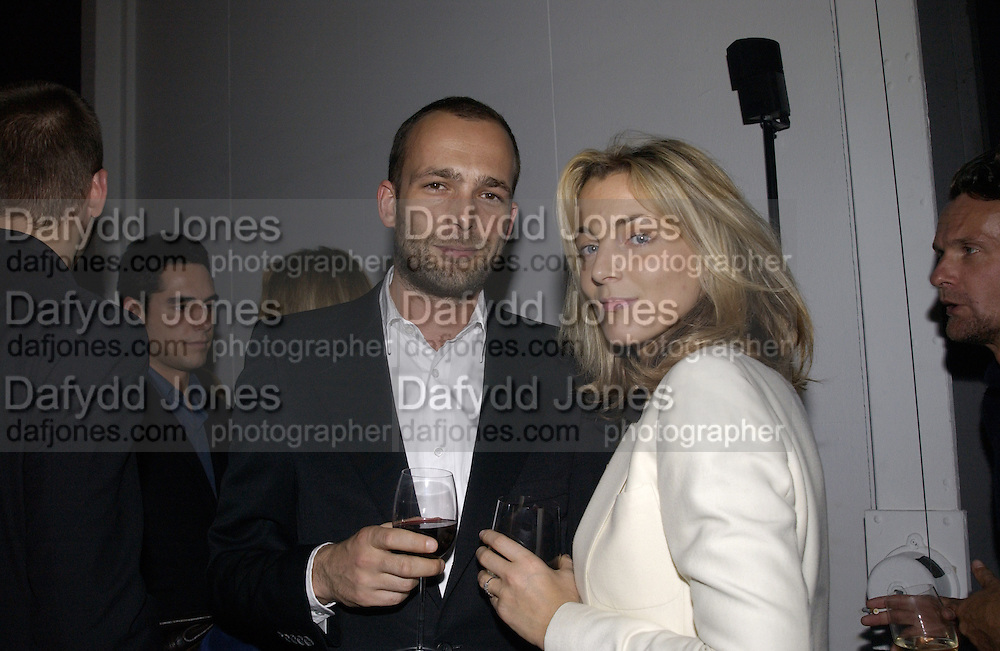 Max Wigram and Phoebe Philo. Vertu phone launch. Musee de Art Moderne de la Ville de Paris. 21 Jan 2002. © Copyright Photograph by Dafydd Jones 66 Stockwell Park Rd. London SW9 0DA Tel 020 7733 0108 www.dafjones.com