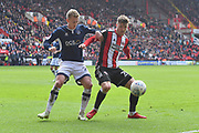 Millwall FC midfielder George Saville (23) and Sheffield United defender Danny Lafferty (24) during the EFL Sky Bet Championship match between Sheffield United and Millwall at Bramall Lane, Sheffield, England on 14 April 2018. Picture by Ian Lyall.