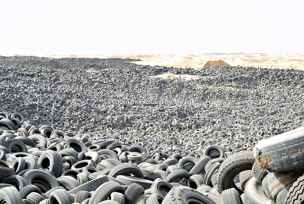 The Tyre Graveyard<br /> <br /> World's biggest tyre graveyard: Incredible images of Kuwaiti landfill site that is home to SEVEN MILLION wheels and so huge it can be seen from space<br /> <br /> An average car tyre will travel around 20,000 miles over its lifetime, but when they have reached the end of their life in Kuwait... they are destined for the tyre graveyard.<br /> <br /> In Kuwait City's Sulaibiya area every year gigantic holes are dug out out in the sandy earth and filled with old tyres - there are now over seven million in the ground.<br /> <br /> The expanse of rubber is so vast that the sizable indents on the earth are now visible from space.<br /> <br /> It is thought the tyres are from both Kuwait and other countries which have paid for them to be taken away - four companies are in charge of the disposal and are thought to make a substantial amount from the disposal fees.<br /> <br /> The European landfill directive means that this type of 'waste disposal would be illegal in Europe -  since 2006 EU rules have banned the disposal of tyres in landfill sites, leaving about 480,000 tonnes of recyclable shredded rubber each year<br /> <br /> In Britain all car and truck tyres must be recovered, recycled and reused.<br /> <br /> Currently, more than 80 per cent of the 55 million used tyres generated in Britain are processed via the Responsible Recycler Scheme.<br /> <br /> The scheme ensures full traceability and accountability of waste tyres throughout the disposal chain, from collection through to their final reuse in an environmentally friendly or acceptable method.<br /> <br /> Materials from properly recycled tyres are used for a variety of uses including a children's playground, running tracks, artificial sports pitches, fuel for cement kilns, carpet underlay, equestrian arenas and flooring.<br /> <br /> Bales of tyres can be used in the construction of modern engineered landfill sites and flood defences. If waste tyres are in good condition, they can be re-moulded and put back on the road as 're-treads'.<br /> <br /> Photo Shows: Over 7,000,000 tires! are left at Tyre Graveyard in Ku