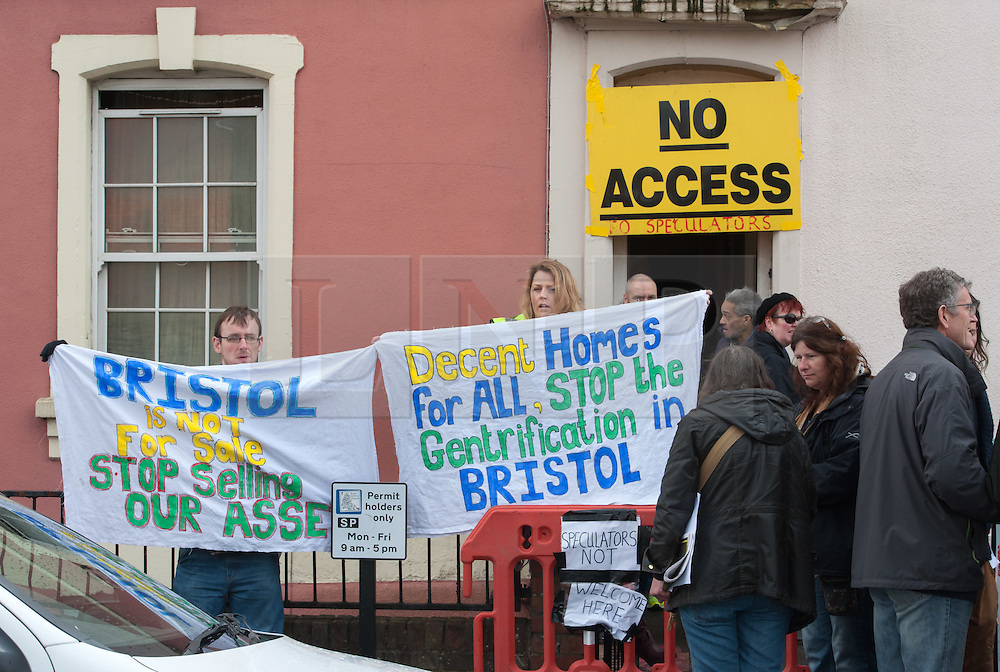 """© Licensed to London News Pictures.09/04/2016. Bristol, UK.  Protest to stop viewings of council houses for auction in City Road, St Pauls, Bristol. Campaigners want the council to stop selling off 15 council homes on 20 April by auction to the private sector. Bristol City Council says the homes are expensive to repair, but some campaigners question whether the costs of repairs are inflated, and also whether the homes will be bought and then relet to the Council for temporary accommodation at higher than normal rents. Bristol resident Roger Yates said: """"The idea the Council can't afford to do these places up is piffle. All over Bristol folk are improving property to increase its value on a rising housing market. These are valuable assets. But Ferguson (Bristol's elected mayor) wants to socially cleanse inner city Bristol so that his luvvie mates can move in. The poor will relocate to Hartcliffe or the street."""" A group of residents of St. Paul's and the Inner City are working together to put pressure on BCC to stop the sale. They are working in partnership with The Community Rights Project, The Bristol People's Assembly, and members of the ACORN community union. Photo credit : Simon Chapman/LNP"""