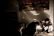 "Middle class heroin addicts prepare doses of white powder in a common room for meetings. Rawalpindi, Pakistan, on wednesday, December 10 2008.....""Pakistan is one of the countries hardest hits by the narcotics abuse into the world, during the last years it is facing a dramatic crisis as it regards the heroin consumption. The Unodc (United Nations Office on Drugs and Crime) has reported a conspicuous decline in heroin production in Southeast Asia, while damage to a big expansion in Southwest Asia. Pakistan falls under the Golden Crescent, which is one of the two major illicit opium producing centres in Asia, situated in the mountain area at the borderline between Iran, Afghanistan and Pakistan itself. .During the last 20 years drug trafficking is flourishing in the Country. It is the key transit point for Afghan drugs, including heroin, opium, morphine, and hashish, bound for Western countries, the Arab states of the Persian Gulf and Africa..Hashish and heroin seem to be the preferred drugs prevalence among males in the age bracket of 15-45 years, women comprise only 3%. More then 5% of whole country's population (constituted by around 170 milion individuals),  are regular heroin users, this abuse is conspicuous as more of an urban phenomenon. The substance is usually smoked or the smoke is inhaled, while small number of injection cases have begun to emerge in some few areas..Statistics say, drug addicts have six years of education. Heroin has been identified as the drug predominantly responsible for creating unrest in the society."""