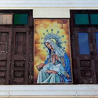 USA, Puerto Rico, San Juan. Tile facade of Madonna and child between windows.