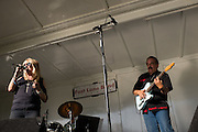 Fast Lane Band's Patty Curtis sings as Pat Curtis plays the guitar during the Milpitas Summer Concert Series at Murphy Park in Milpitas, California, on July 14, 2015. (Stan Olszewski/SOSKIphoto)