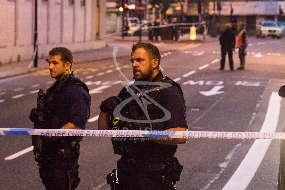 """Finsbury Park, London, June 19th 2017. A major police and emergency services operation with firearms officers in attendance is underway near Finsbury Park Mosque following reports of Several people being injured after a van struck a crowd of pedestrians near a north London mosque in what police have called a """"major incident"""". PICTURED: Armed police man the cordon surrounding the area."""