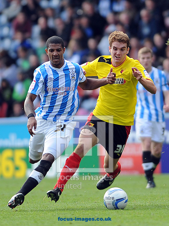 Picture by Graham Crowther/Focus Images Ltd +44 7763 140036.29/09/2012.New signing Jermaine Beckford of Huddersfield Town battles with Tommie Hoban of Watford during the npower Championship match at the John Smiths Stadium, Huddersfield.