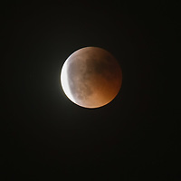 VENICE, ITALY - JUNE 15:  Final stages of the total Lunar eclipse is seen on June 15, 2011 in Venice, Italy. The longest lunar eclipse for a decade took place tonight, a lunar eclipse comes when the sun, Earth and moon line up and Earth's shadow falls on the moon