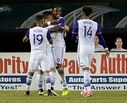 September 9, 2017 - Washington, DC, USA - 20170909 - Orlando City FC forward CYLE LARIN (9) celebrates with Orlando City FC forward GILES BARNES (14), Orlando City FC midfielder YOSHIMAR YOTUN (19) and Orlando City FC forward DOM DWYER (18), following his goal against D.C. United in the first half at RFK Stadium in Washington. (Credit Image: © Chuck Myers via ZUMA Wire)
