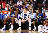 Sep 11, 2011; Phoenix, AZ, USA; Minnesota Lynx forward Rebekkah Brunson (32) , guard Lindsay Whalen (13) , and forward Taj McWilliams-Franklin (8) react on the bench while playing against the Phoenix Mercury during the first half at the US Airways Center.  The Lynx defeated the Mercury 96-90. Mandatory Credit: Jennifer Stewart-US PRESSWIRE