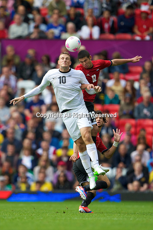 29.07.2012 Manchester, England. New Zealand forward Chris Wood and Egypt defender Islam Ramadan in action during the first round group C mens match between Egypt and New Zealand.