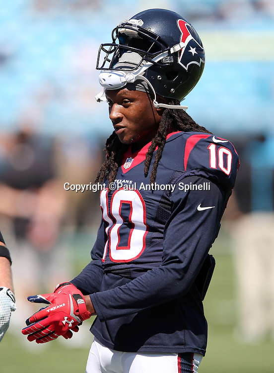 Houston Texans wide receiver DeAndre Hopkins (10) adjusts his gloves while warming up before the 2015 NFL week 2 regular season football game against the Carolina Panthers on Sunday, Sept. 20, 2015 in Charlotte, N.C. The Panthers won the game 24-17. (©Paul Anthony Spinelli)