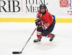 MOON TOWNSHIP, PA - SEPTEMBER 14:  Amber Rennie #23 of the Robert Morris Colonials handles the puck in the third period during the game against the Toronto Jr. Aeros at the 84 Lumber Arena on September 23, 2016 in Moon Township, Pennsylvania. (Photo by Justin Berl)