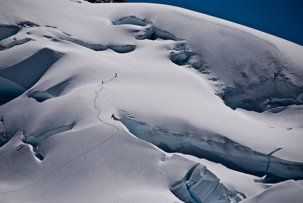 Blake Harrington and David Trippet make their way across the Piedra Blancas glacier enroute to Aguja Guillaumet, in the Argentine Patagonia.