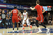 SMU Mustangs guard Kendric Davis (3) brings the ball down while the defense of Hartford Hawks guard Traci Carter (25) and  Hunter Marks (0) set up during an NCAA college basketball game, Wednesday, Nov. 27, 2019, in Dallas.SMU defeated Hartford 90-58. (Wayne Gooden/Image of Sport)