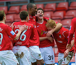 WREXHAM, WALES - Saturday, February 14, 2009: Wrexham's Ryan Flynn, on loan from Liverpool, celebrates scoring the second goal against Grays Athletic with team-mates Jefferson Louis, Marc Williams and Nathan Fairhurst during the Blue Square Premier League match at the Racecourse Ground. (Mandatory credit: David Rawcliffe/Propaganda)