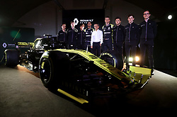 Drivers Nico Hulkenberg (right) and Daniel Ricciardo pose with retired racing driver Alain Prost (centre) during the Renault F1 Team 2019 season launch at Whiteways Technical Centre, Oxford.