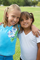 Two girls (7-9 years) hugging, portrait