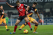 Bradford City midfielder Daniel Devine (24)  and Morecambe Midfielder Andrew Flemming battle during the EFL Trophy match between Morecambe and Bradford City at the Globe Arena, Morecambe, England on 9 November 2016. Photo by Pete Burns.