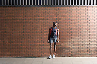Man in sports clothing standing in front of wall