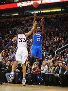 Feb. 4, 2011; Phoenix, AZ, USA; Oklahoma City Thunder forward Kevin Durant (35) puts up a shot against Phoenix Suns forward Grant Hill (33) at the US Airways Center. Mandatory Credit: Jennifer Stewart-US PRESSWIRE
