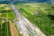 Nederland, Zuid-Holland, Rotterdam, 10-06-2015; Polder Vockestaert. Aanleg A4 Midden-Delfland. De nieuwe weg loopt tussen de wijken Holy-Zuid (Vlaardingen) en Groenoord (Schiedam) naar Delft (aan de horizon).  In de voorgrodn de uitgang van de tunnel.<br /> Construction A4 between Delft and Rotterdam.<br /> luchtfoto (toeslag op standard tarieven);<br /> aerial photo (additional fee required);<br /> copyright foto/photo Siebe Swart