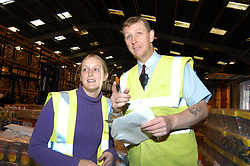 Young trainee with manager in warehouse; Merseyside; UK