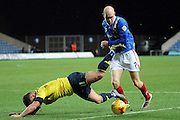 Carlisle United midfielder Jason Kennedy tackles Oxford United midfielder Alex MacDonald during the Sky Bet League 2 match between Oxford United and Carlisle United at the Kassam Stadium, Oxford, England on 12 December 2015. Photo by Alan Franklin.