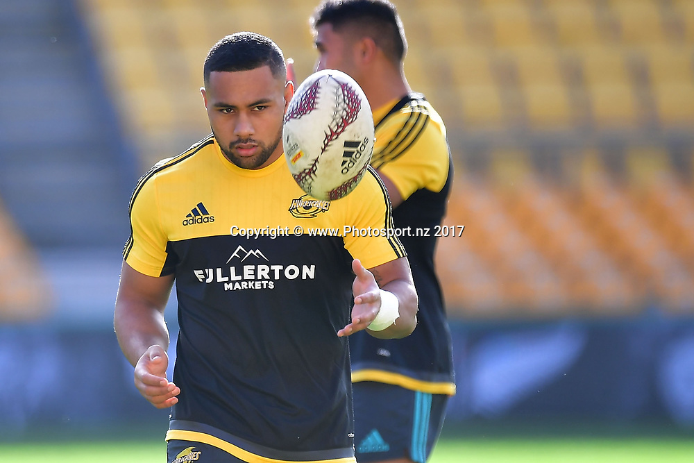 Hurricanes Ngani Laumape makes a pass during the Hurricanes captains run at Westpac Stadium in Wellington on Friday the 26th of June 2017. Copyright Photo by Marty Melville / www.Photosport.nz