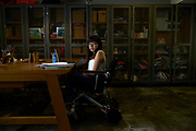 Nalutporn Krairiksh, a Thai journalist in the newsroom of Pratchatai News Agency. She has been physically disabled since she was born having to use a wheelchair and regularly reports on news the rights and issues of disabled members of Thai society.