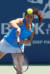 July 31, 2011; Stanford, CA, USA;  Marion Bartoli (FRA) serves the ball against Serena Williams (USA), not pictured, during the finals of the Bank of the West Classic women's tennis tournament at the Taube Family Tennis Stadium. Williams defeated Bartoli 7-5, 6-1.