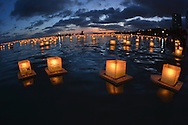 Floating Lanterns at dusk in Ala Moana Beach during Memorial Day celebration, Honolulu, Hawaii, USA