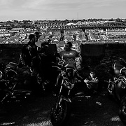 Attendees mill around the Derry Walls during the 11th anniversary of The Roaring Meg custom, classic bike show. The high-profile event  raises money for local charities. Northern Ireland, September 2019