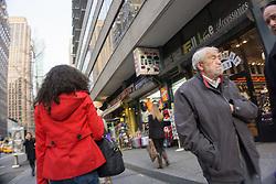 people walking on the street in Midtown New York City