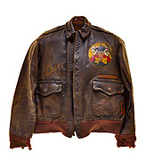 "This type A2 flight jacket was worn by Dale Livingston, a pilot on ""The Baby Buggy"". The 570th squadron patch is attached to the front of the jacket, and the crews name ""The Baby Buggy"" is painted above the 8th air force logo on the back of the jacket. Each bomb painted on the jacket signifies a completed mission. Livingston, his crew, and their aircraft received the nickname ""The Baby Buggy"" due to the average age of their crew, which was less than 21 years old. The crew also completed one of the fastest combat tours, they finished their 35 combat missions in 4 months, from June 1944 to September 1944."