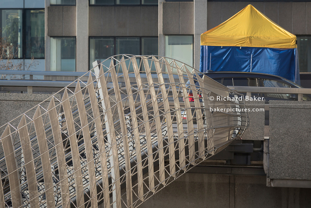 The morning after the terrorist attack at Fishmongers Hall on London Bridge, in which Usman Khan (a convicted, freed terrorist) killed 2 during a knife a attack, then subsequently tackled by passers-by and shot by armed police - the forensic tent where the killer was brought down is positioned near to Fishmongers Hall, on 30th November 2019, in London, England, on 30th November 2019, in London, England.