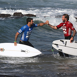 Willian Cardoso left of Brasil is congratulated by Mikey Wright of Australia after their semi final. during the The Ballito Pro at Willard Beach, Ballito, South Africa. (Photo Brian Spurr)