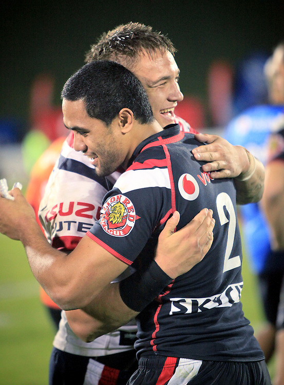 Warriors Bill Tupou, left and Roosters Jared Waerea-Hargreaves embrace after the NRL Rugby League match at Mt Smart Stadium, Auckland, New Zealand, Saturday, May 12, 2012. Credit:SNPA / Matt Campbell