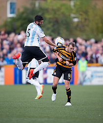 Hearts Alim Ozturk and Alloa Athletic's Greig Spence.<br /> half time : Alloa Athletic 0 v 0 Hearts, Scottish Championship played at Recreation Park, Alloa.