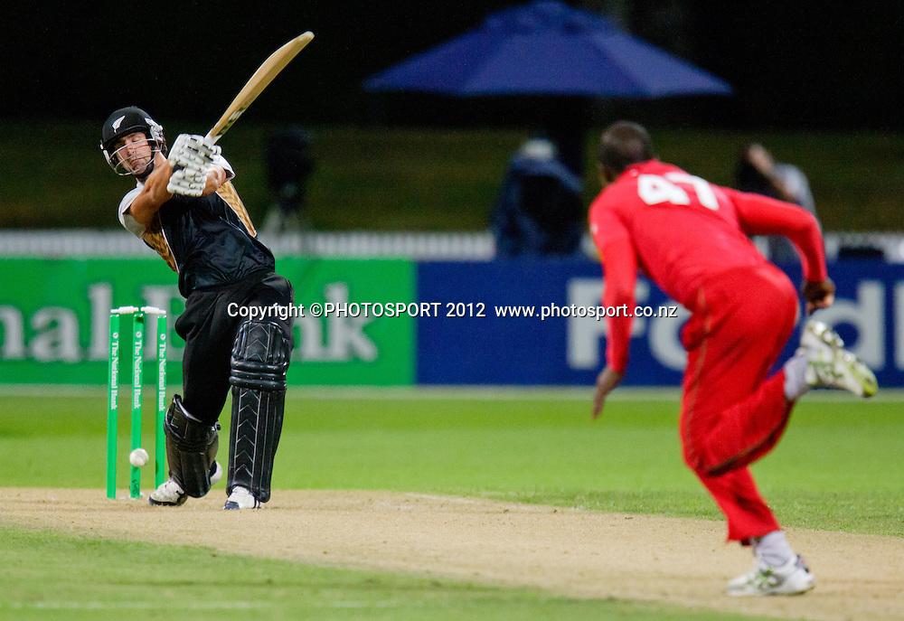 Colin de Grandhomme is bowled by Elton Chigumbura during the 2nd International Twenty-20 cricket match, New Zealand vs Zimbabwe, Seddon Park, Hamilton, New Zealand, 14 February 2012. Photo: Stephen Barker/PHOTOSPORT