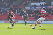 Plymouth Argyle midfielder Matthew Kennedy (16) takes shot at goal  during the EFL Sky Bet League 2 match between Doncaster Rovers and Plymouth Argyle at the Keepmoat Stadium, Doncaster, England on 26 March 2017. Photo by Ian Lyall.