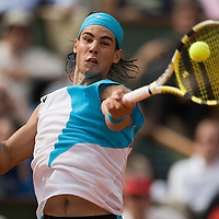 04 June 2007: Spanish player Rafael Nadal hits a forehand shot to Australian player Lleyton Hewitt during the French Tennis Open fourth round match won 6-3, 6-1, 7-6 (7/5) by Rafael Nadal over Lleyton Hewitt on day 9 at Roland Garros, in Paris, France.
