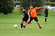 The Maidens (black) v DUSC (tangerine) in the Dundee Saturday Morning Football League at Drumgeith