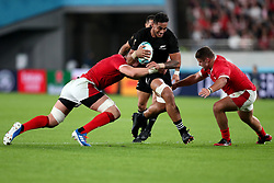 Shannon Frizell - New Zealand flanker powers through the tackle of Alun Wtn Jones - Wales captain (L).<br /> New Zealand v Wales, Rugby World Cup, Bronze Final, Tokyo Stadium, Tokyo, Japan, Saturday 1st November 2019. ***Please credit: Fotosport/David Gibson***
