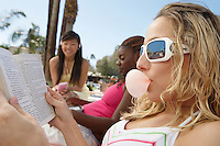 Three Young Women Relaxing Outdoors