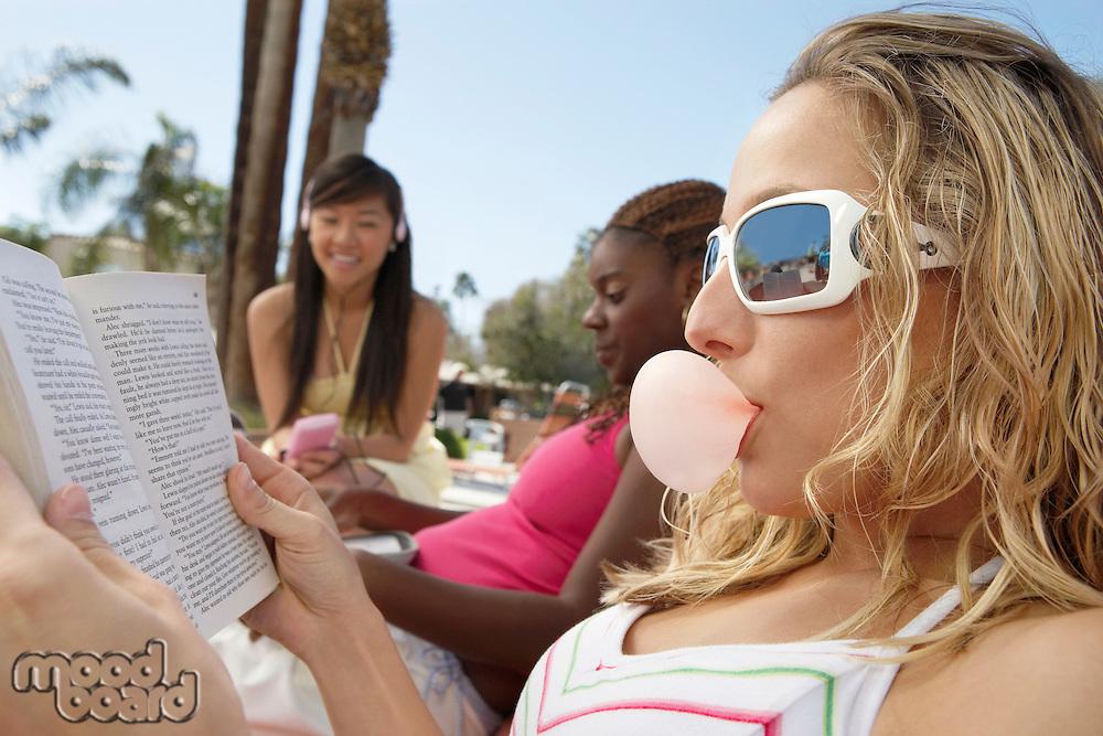 Three Young Women Relaxing Outdoors