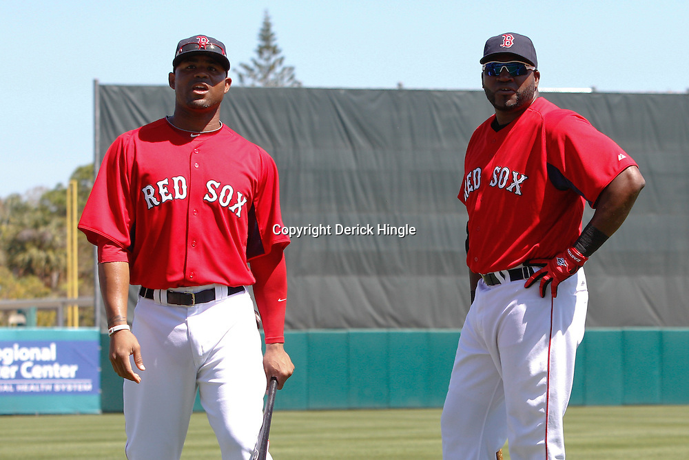 March 7, 2011; Fort Myers, FL, USA; Boston Red Sox left fielder Carl Crawford (13) and first baseman David Ortiz (34) before a spring training exhibition game against the Baltimore Orioles at City of Palms Park.   Mandatory Credit: Derick E. Hingle